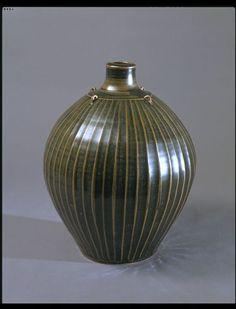Vase : Leach, Bernard : V&A, stoneware with tenmoku glaze and vertical ribbing.