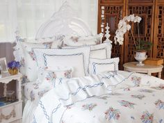 Country Garden - Floral sprays in pretty blues and pinks dance across silken 300 thread count 100% Egyp-tian cotton for a delightful, energizing effect. Tailored in Italy, in sateen, the scalloped borders are finished with white tape.