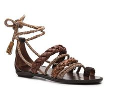 This is the type of shoe that I would expect in this time period. They appear handmade and are as a whole the shoe I would like to see on the women in the Acropolis.