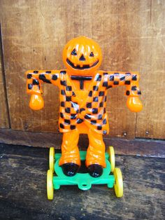 Vintage 1950's Halloween Candy Container Pull Toy, Scarecrow with Jack-o-lantern Head on Wheels.
