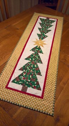 Patchwork Table Runner Tutorial Simple 20 ideas 56 ideas for patchwork table ideas for patchwork table runnersFree Jelly Roll Table Runner Patterns Designs)Table runner pattern with jelly roll stripes. Christmas Tree Quilted Table Runner, Christmas Patchwork, Patchwork Table Runner, Christmas Quilt Patterns, Christmas Placemats, Christmas Runner, Table Runner And Placemats, Christmas Crafts, Christmas Trees