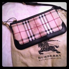 "MINT CONDITION Authentic Cross Body Check Burberry Signature check PVC with smooth leather trim. Golden hardware; tonal topstitching. Removable adjustable crossbody strap, 22"" drop. Zip top closure. Logo nylon lining. 5 1/2""H x 10""W x 1""D. This is a mint condition sold out bag! Burberry Bags Crossbody Bags"