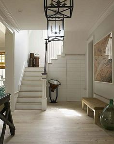 Steven Gambrel designed entry with large scale photograph love the bench under the photo / lights