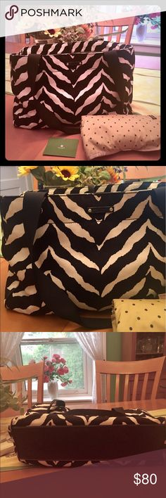 Kate Spade black and white zebra diaper bag Authentic Kate Spade black and white diaper baby bag with zebra pattern. Fabric with black leather trim. Shoulder strap plus extra strap that allows you to carry it on your stroller. Ribbon closure at top. Lots of interior pockets. Includes changing pad. I used this for my daughter so it's been used and loved but still in great condition. But it's used so not perfect. Zoom in for a few small marks on the exterior fabric and interior. Can also be…