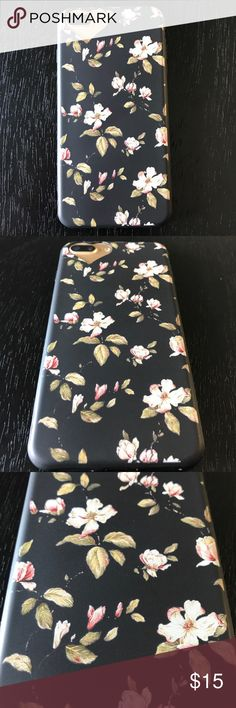 iPhone 📱 7 Plus Flower Print Case Flower Print Case with heart cut out for camera. For iPhone 7 Plus, 6 Plus or 6s Plus. Lightening port cover to protect from dust. Very nice textured flower Print Case. Brand new, never used. Bundle 3 or more items to save 15% and only pay shipping once. 💰 Accessories Phone Cases