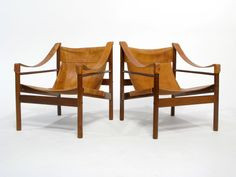 Leather Sling Lounge Chairs. I sat in these, so comfortable. They sold them without asking me!