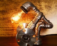 *Approximate dimensions: 10 x 10 x 7 x x *Style: Antique; Applicable Space: Square meters Materials: cast iron, water pipe, iron pipe, plumbing pipe, cast iron pipe *Voltage: - AC and everything in between; Urban Industrial Lamps are hand crafted with Diy Light Fixtures, Industrial Light Fixtures, Industrial Lighting, Vintage Lighting, Urban Industrial, Vintage Industrial, Industrial Table, Industrial Interiors, Industrial Furniture
