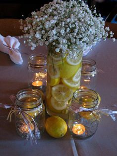 Totally doing this for the centerpieces. Probably using Mason Jars (lower profile for a daytime wedding). Using lemons and oranges - maybe even some limes. Using rafia and ribbon to tie at the top of tghe mason jars.