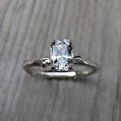 Non-Diamond Engagement Rings that Sparkle Just as Bright – Part 1:  Emerald Cut Engagement Ring White Sapphire