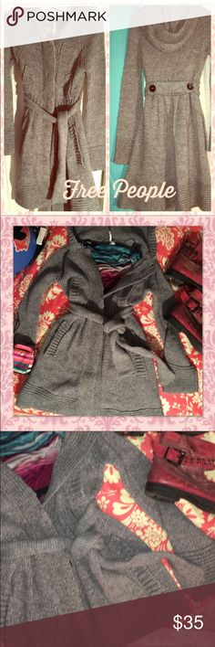 🌸Free People🌸long belted grey sweater 🌺FREE PEOPLE LONG CARDIGAN SWEATER 🌺grey with side pockets, 2 small pockets on top, belt w/lining, buttons down front , size is XS RUNS SMALLReally cute. Great condition Free People Sweaters Cardigans