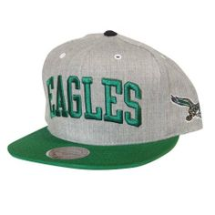 Mitchell & Ness Philadelphia Eagles Basic Arch Grey 2t Snapback Hat by Mitchell & Ness. $25.00. Vintage team logo embroiderd on left side, 2-color plastic back snap. 100% wool adjustable snap back cap. Green undervisor, contrast color top button and visor, white metal eyelets. Basic arch front wordmark on light heather wool crown. Contrast binding around back opening with Mitchell & Ness wordmark above. Mitchell & Ness The Philadelphia Eagles Basic Arch Snapback Hat. Flat brim s...