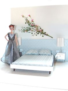 loving the  bed and light blue.  Cool the floral on the wall.