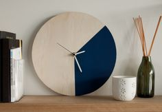 Mr. Wolf in Navy Blue by The Curious Craftsmen. Handcrafted from plywood and hand painted in Aqua. Diameter: 270mm