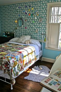 Oh this room!  The iron bed!  The quilt!  The walls!  The mobile!