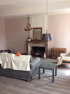 Not yet finished but looking better right? Walls are Calamine by Farrow and Ball and lights are Graham and Green.