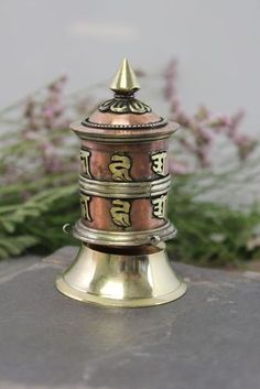 http://www.dharmashop.com/small-desktop-prayer-wheel/ $35