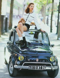 Kate Moss on top of a Fiat 500 (1958). Photo Arthur Elgort for Vogue Italia September 1993