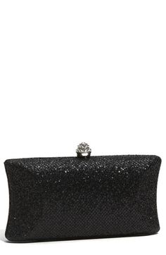 To top off the Night on the Town outfit, this classic black clutch with a (fantastic) little bit of sparkle!  Love how the stone ties in with the ring.