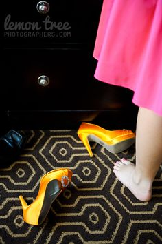 Orange Wedding Shoes on the floor at The Hotel Julien in Dubuque by http://www.lemontreephotographers.com