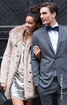 Ready to ring in the New Year? We've got NYE outfit inspo galore. For her: we're loving a flirty sequin dress (with a layered cutout back, ahem) worn with a faux fur coat, and festive accessories to add sparkle. For him: a classic grey suit, a crisp white collared shirt and a charming hunter green bowtie.