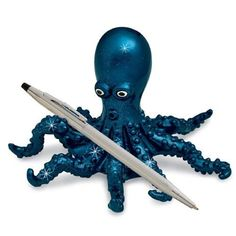 His long tentacles balance a pen or two and his personality shines! Durable polyresin in a deep blue finish that sparkles with iridescent glitter. Pen not included.