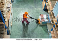 worker with fork pallet truck  in warehouse