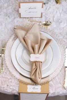 Lavender and blush pink roses, white hydrangeas. Floral garlands for the reception tables and the sweetheart table. Gold mercury glass vases and gold, blush, and cream linens.