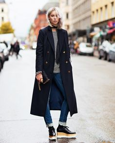 Love this casual look. Appreciating the long dark coat with gold buttons and YES, I'm digging the shoes (a little Munster'ish) statement piece  - winning! Tx
