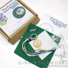 This kit contains everything you need to create a pretty perfumed brooch!During the Victorian period, metal buttons were manufactured with a cloth section - a place to put perfume so that the oils did not stain clothing. These brooch kits bring this idea forward, and make a pretty gift.The button is worked in counted cross stitch, while the other parts of the brooch include basic embroidery. The box contains full instructions,all materials - even a little vial with perfume oil!There are two…