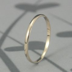 Solid 14K Gold 1.5mm Skinny Minnie Plain Jane Half Round Band--YOUR CHOICE of 14K Yellow, White or Rose Gold--Simple Solid Gold Wedding Band. $80.00, via Etsy.