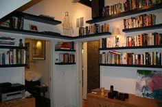 attic remodel - floating bookshelves