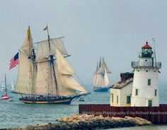 Lighthouse with Tall Ships