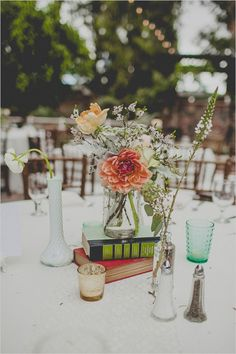 simple book and floral centerpiece #weddingdecor #diy #weddingchicks http://www.weddingchicks.com/2014/02/12/california-ranch-wedding/