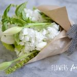 Hostess Gift: Flowers . How to package so that it's easy for hostess to pop in a vase.