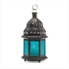 """$5.87 Wholesale Lantern with Blue Glass @ http://www.wholesalemart.com/Wholesale-Candle-Lanterns-s/294.htm - The cobalt hues of this exotic metal candle lantern bring to mind images of mysterious Morocco! The cobalt hues of this exotic metal candle lantern bring to mind images of mysterious Morocco! Suitable for hanging or use as a freestanding lamp. Metal and glass. Candle not included. 4 1/2"""" x 3 3/4"""" x 10 1/4"""" high."""