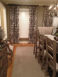 Drapes with pattern against taupe walls. Simple rod at crown molding height.