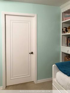 An Easy & Inexpensive Way To Update Flush (Flat Panel) Interior Doors With Moulding with DIY instructions.