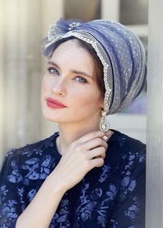 Romantic blue wrap head covering. Made of cotton and rich tulle, decorated with a gorgeous, pearl-sprinkled, flower.