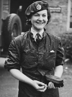 A wet WAAF woman who was cleaning a lorry during world war II