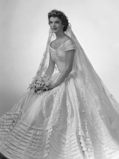 Jacqueline Kennedy Onassis in her wedding gown 12 September .cited as iconic and one of the best-remembered bridal gowns of all time. The wedding gown was the creation of Ann Lowe ft) of ivory silk taffeta. Jacqueline Kennedy Onassis, Jackie Kennedy Wedding, Jaqueline Kennedy, Jackie O's, John Kennedy, Caroline Kennedy, Jacklyn Kennedy, Jacqueline Kennedy Jewelry, Jackie Kennedy Style