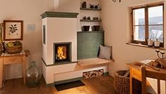 masonry stove , I want one similar to this in my house but with a longer bench and cooking facilities. Small Hallway Decorating, Wood Stove Heater, Diy Heater, Solid Fuel Stove, Small Hallways, Traditional Fireplace, Rocket Stoves, New House Plans, Home Bedroom
