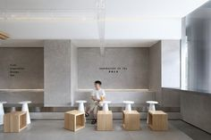 Images by Xiaole Cheng. The design is located in Foshan, the hometown of martial arts, where was once famous for Wing Chun. UND tries to integrate modern aesthetics with. Restaurant Interior Design, Shop Interior Design, Cafe Design, Retail Design, Store Design, Design Design, Cafe Shop, Cafe Bar, Deco Cafe