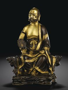 A parcel-gilt bronze figure of a seated luohan, Ming Dynasty, Hongzhi Period, dated in accordance with 1496