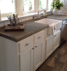 Joanna Gaines Like the color of the concrete countertops and flooring                                                                                                                                                                                 More