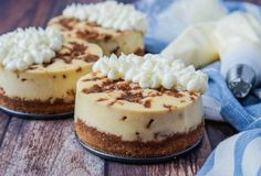 Cinnamon Roll Cheesecake for #BakingBloggers! This decadent cheesecake has a cinnamon graham cracker crust and a creamy filling dotted with pieces of a sweetened cinnamon mixture. Top it off with a cream cheese icing for a showstopper dessert.