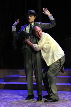 James Beard (Conrade) and Patrick Tansor (Borachio), Much Ado About Nothing, directed by Nick Hutchison, Folger Theatre, 2005. Photo by Carol Pratt .