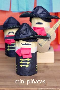 This Mini Piñata Tutorial shows you how to make a handsome mariachi band from cardboard toilet paper tubes and tissue paper for your Cinco de Mayo party.