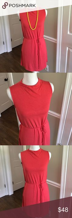Anthropologie coral tunic Small Anthropologie tunic in a orange/coral color, so pretty and soft! Size small. Can be worn with leggings or jeans. Brand is Dolan Anthropologie Tops Tunics