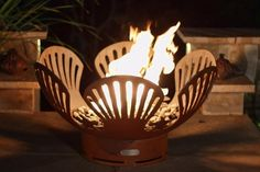 The Barefoot Beach Natural Gas or Propane Outdoor Fire Pit is a high quality, hand cut and crafted fire pit designed for years of heavy use.