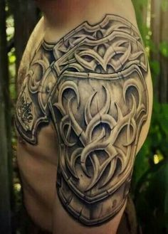 The design shows a strong armour covering the shoulder, sleeves and chest. The armour is decorated with beautiful tribal designs which are a very popular type of art when it comes to designing tattoos. They look attractive and has deep meaning.